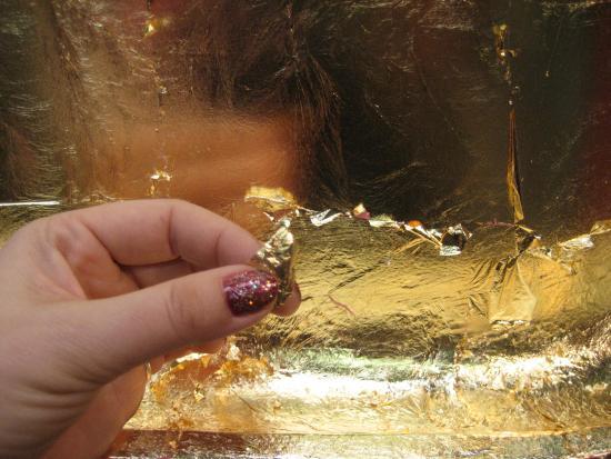 Gold leafing our bathtub. Photo by Tui Cameron