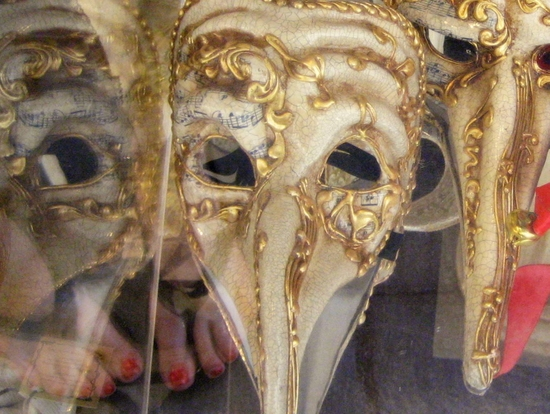 My red painted toes reflected in a Venice mask shop. (photo by Tui Cameron)