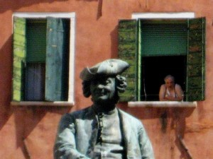 Statue and man in Venice, Italy. (photo by Tui Cameron)
