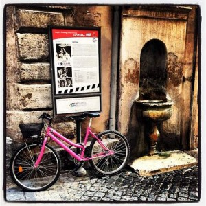 Pink bike & ancient Romans fountain (photo by Tui Snider)