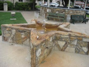 Petrified wood water fountain in Glen Rose, TX (photo by Tui Snider)