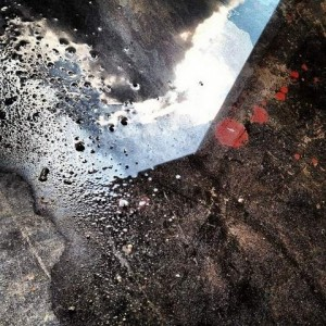Clouds peek through a puddle in the floor (photo by Tui Snider)