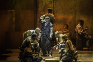 Kingsley Leggs as Sporting Life and the cast of The Gershwins' Porgy and Bess. Photo by Michael J. Lutch.