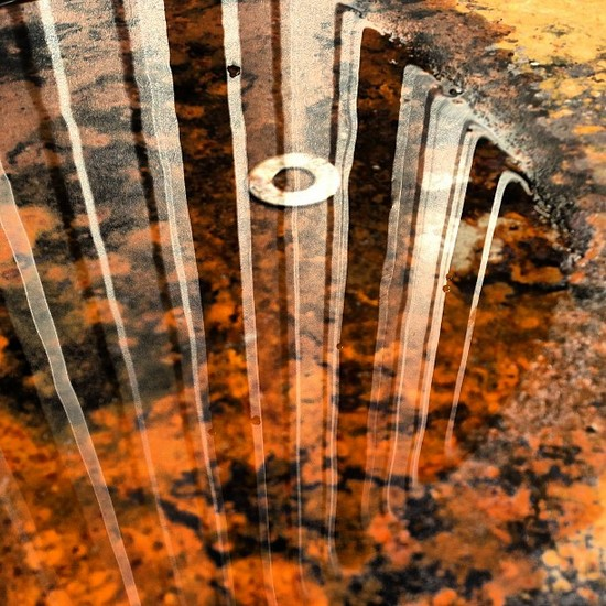 Reflections in a rusty barrel (photo by Tui Snider)