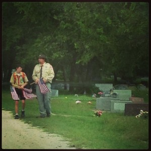 Boy Scout troop placing flags on soldier's graves for Memorial Day in Texas