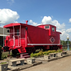 Red caboose near the Beckham Hotel in Mineola, Texas (photo by Tui Snider)