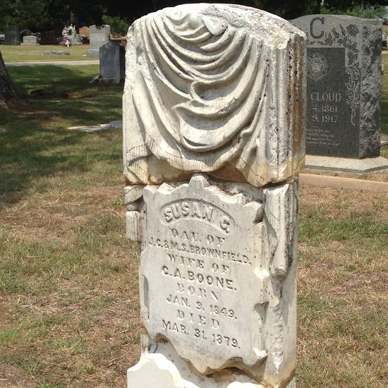 Faux cloth draped on a headstone. (photo by Tui Snider)