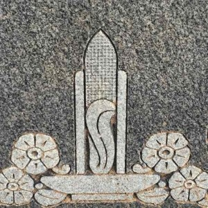 Ear of corn on a headstone (photo by Tui Snider)