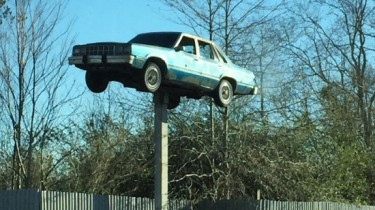 Quirky road trip: Car on a stick! (photo by Tui Snider)