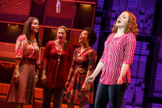 "Natural Woman. Foreground: Abby Mueller (""Carole King""). Background: (l to r) Britney Coleman, Sarah Bockel and Ashley Blanchet. Beautiful: The Carole King Musical. Photo by Joan Marcus"