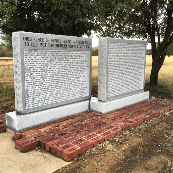 These marble monuments in Thurber Cemetery replace the ones vandalized in 2010. (photo by Tui Snider)