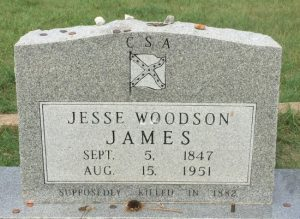 (c) Tui Snider - Visitors often leave coins on the grave of Jesse James in Granbury, TX