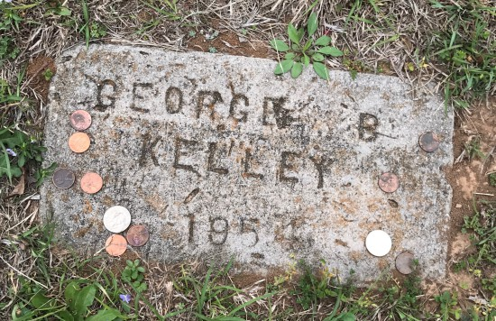 (c) Tui Snider - Visitors often leave coins on the grave of Machine Gun Kelley in Paradise, TX