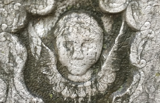 "(c) Tui Snider - a ""death's head,"" or ""soul effigy."""