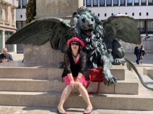 Tui Snider and winged lion in Venice. photo (c) Larry Snider